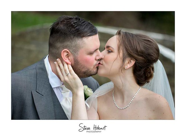 The Bride and Groom first kiss at thetford wedding photography