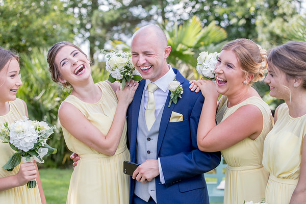 a candid moment with the groom and the bridesmaids at Holkham Hall