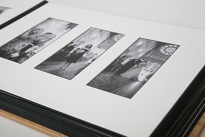 "An Art album with matted prints. 14""x11"" in size."
