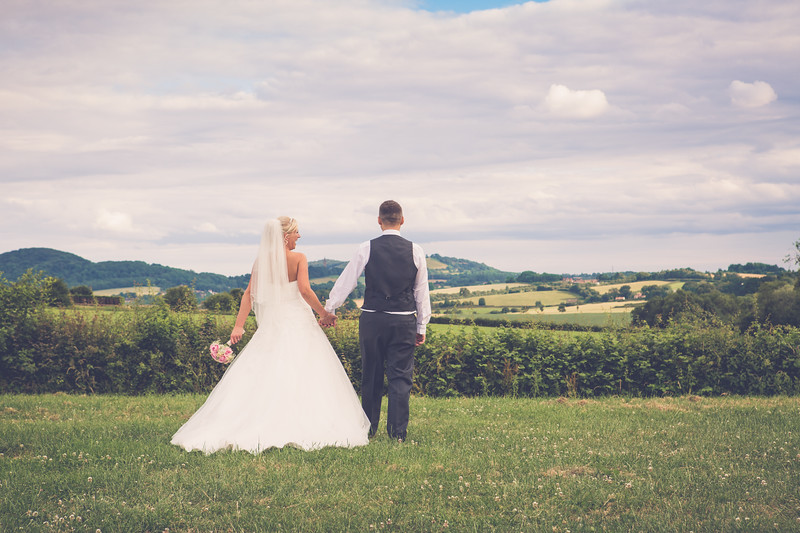 Bride & groom countryside walk.