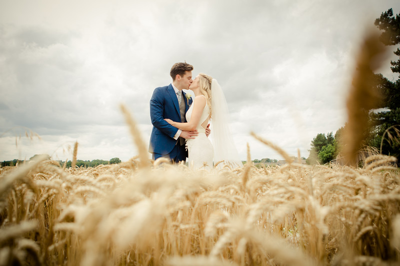 Bride & Groom cornfield kiss.