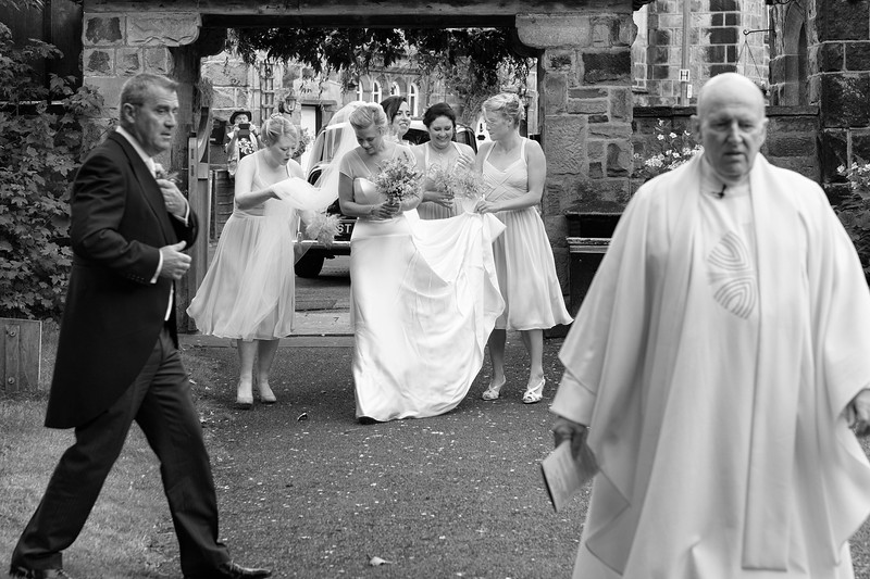 www.davidaveyard.co.ukI love the sheer activity here as the bride arrives. Each group looks pre-occupied with their particular role in the day.  I was feeling the same sense of anticipation.  The bride seems a remarkably calm centre.