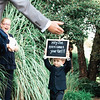 ringbearer-holds-sign-chester-valley-golf-club-malvern-pa-wedding-kate-timbers-photography-4507