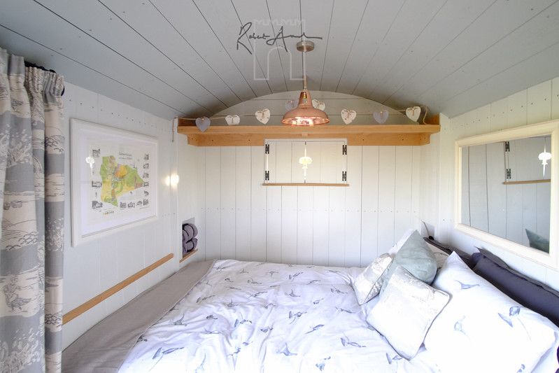 Comfortable bed in light airy shepherd hut