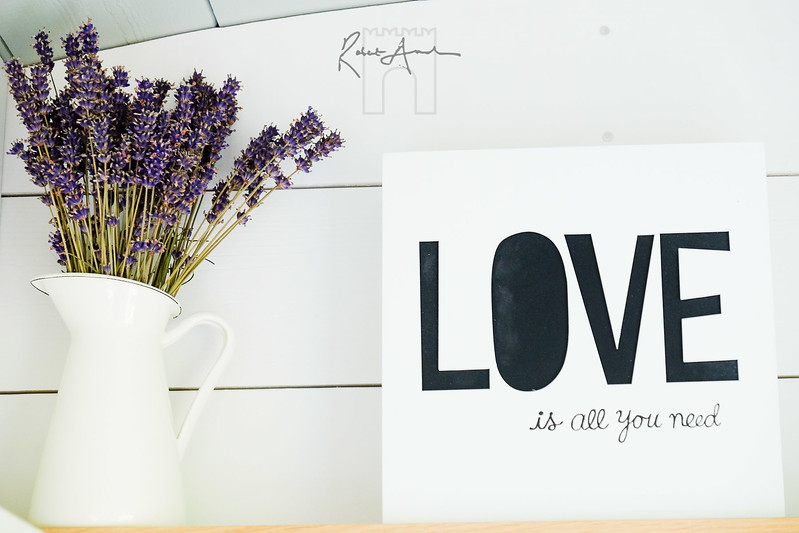 love is all you need poster and jar of lavender