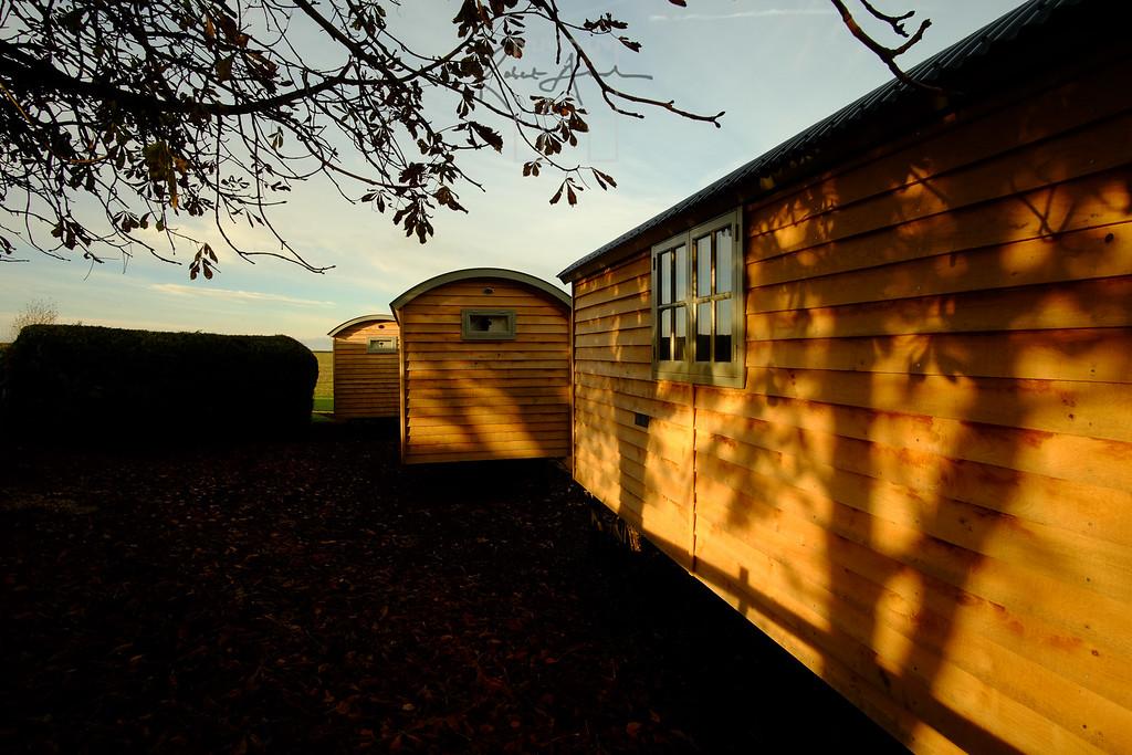 Sunlit shepherd huts