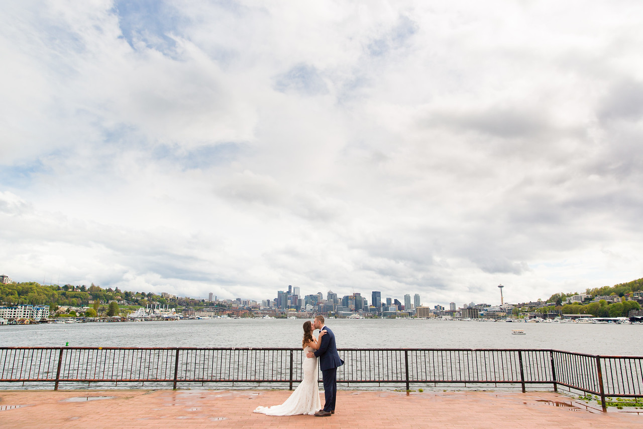 "Jeff + Lauren's First Look at Gasworks couldn't have been more perfect. The forecast said 70% chance / 0.5"" of rain for the day. Jeff & Lauren bought 8 umbrellas, I brought my 12 (they have a big bridal party!), and we were ready to use them! But I kept telling Lauren all morning that things are going to work out, and hey, by looking at this photo I think you can agree!"