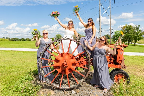 Bride and bridesmaids on an old tractor