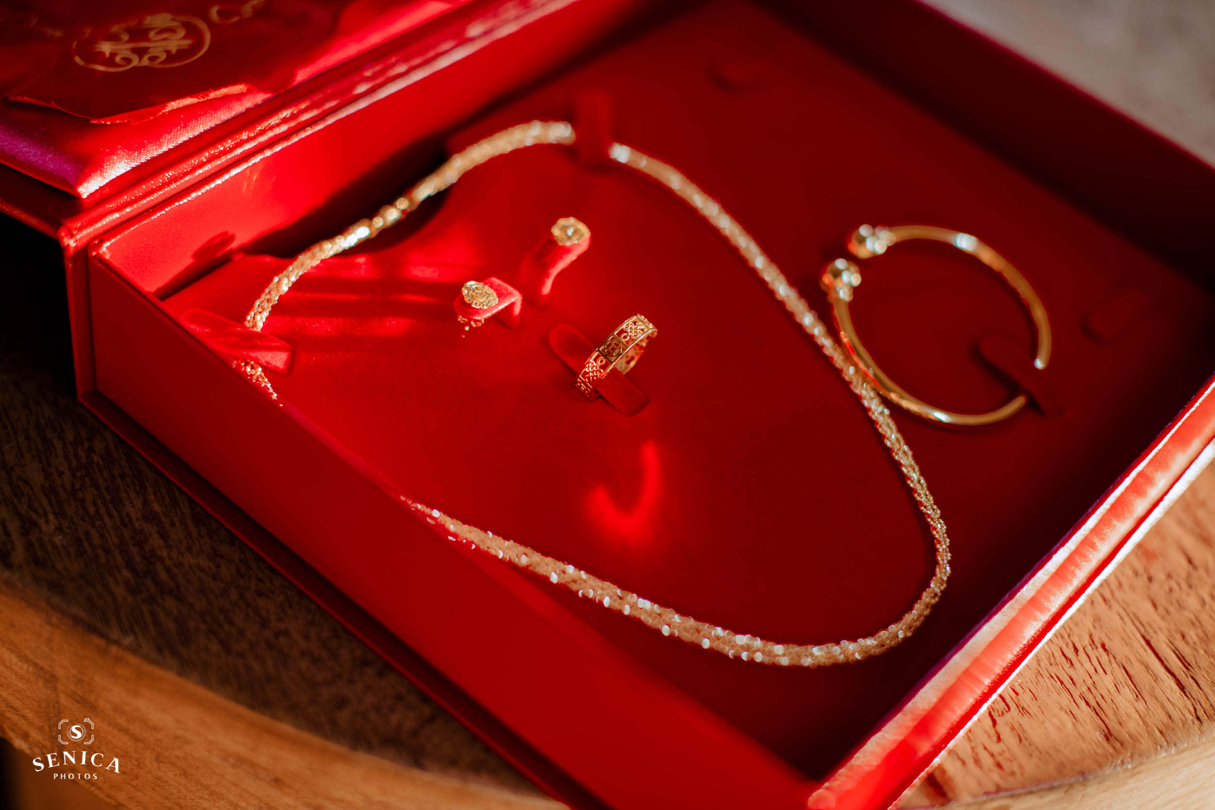 four-piece jewellery set in a red box