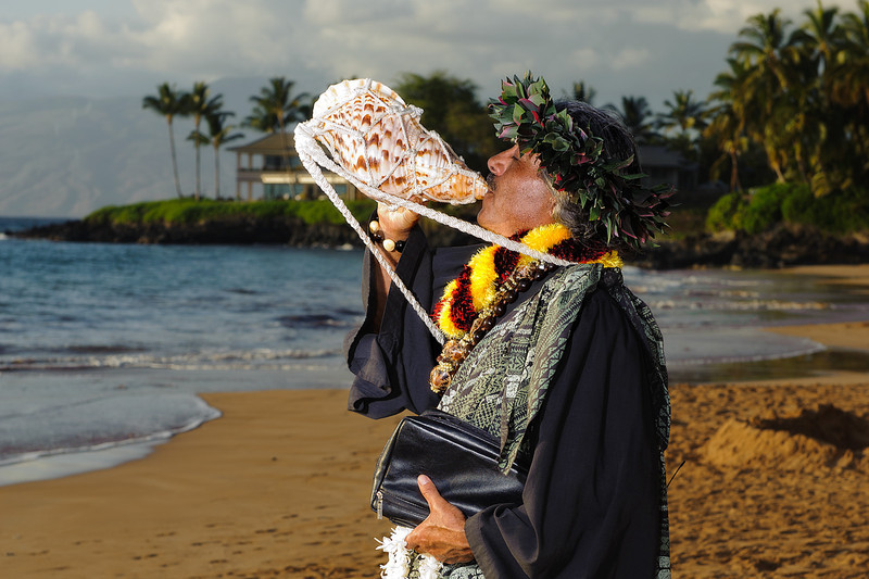 February 14, 2012:  Rev. Dennis Clyde De Rego blows his conch shell to start the ceremony.