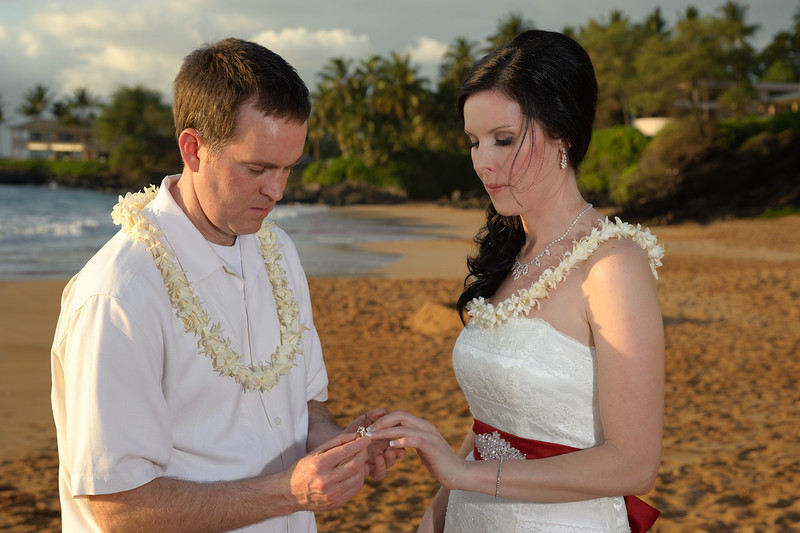 February 14, 2012:  Jeff places the ring on Erin's hand.