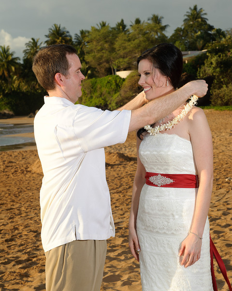 February 14, 2012:  Jeff places a traditional Hawaiian lei on Erin.