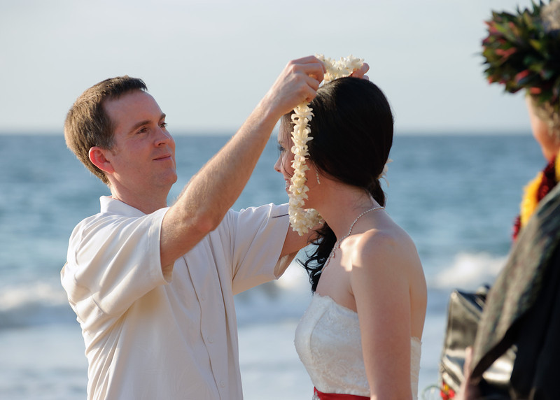 February 14, 2012:  Jeff places a traditional Hawaiian lei over Erin's head.