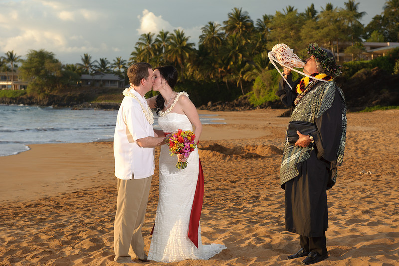 February 14, 2012:  Rev. De Rego blows the conch shell as Jeff kisses his bride.