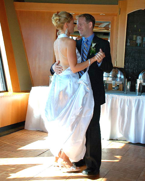 """And for our final moments before heading off for our Honeymoon Cruise to Hawaii we enjoyed our 1st dance (to Peter Gabriel's """"Book of Love"""") as Mr. & Mrs. Power... we know what you're thinking... """"awe, how sweet""""! :-)"""