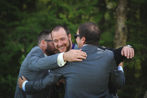 Group hug with the groom and his best men