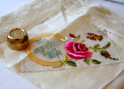 A brides hankie and gold rolo on her wedding day at Butley Priory