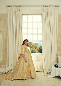 A lovely bride in her gold wedding dress at Butley Priory before her wedding ceremony and reception