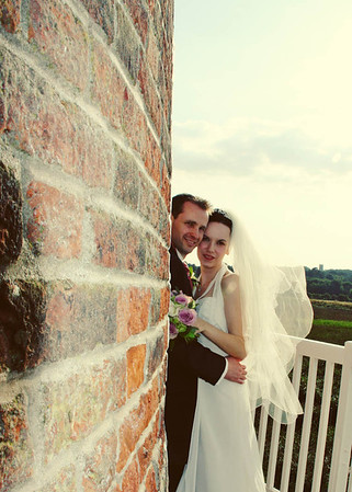 Beautiful couple photographed on their wedding day at Cley Windmill