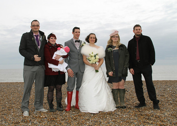 A wedding party on Cley Beach before returning to Cley Windmill for their wedding breakfast