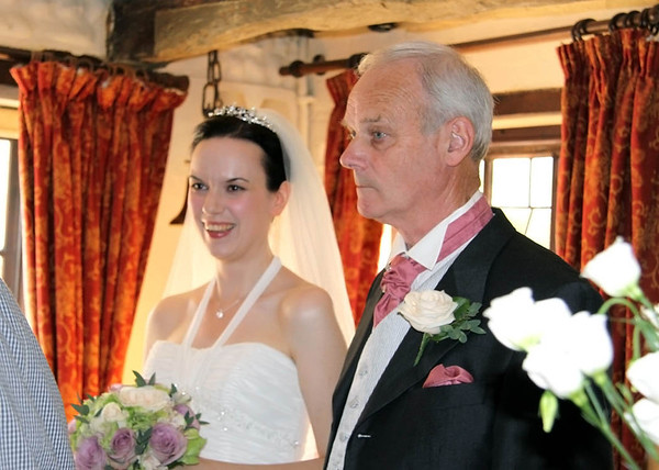 A bride and her dad waiting to come in for her ceremony at Cley Windmill