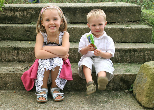 Cute children sat on the steps during a wedding reception at Cley Windmill