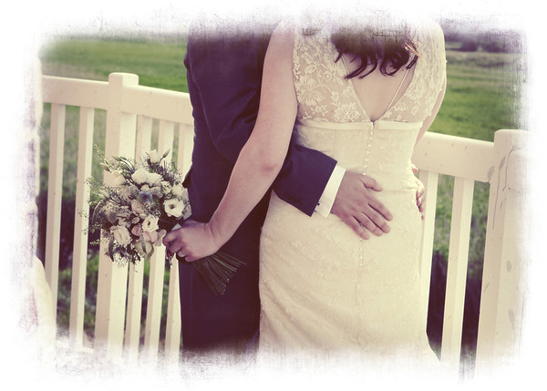 Cuddling on the balcony at Cley Windmill at a wedding