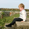 A little boy sat down during a wedding reception at Cley Windmill
