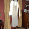 A wedding dress hanging at Cley Windmill before the getting ready started
