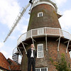 A groom at Cley Windmill on his wedding day