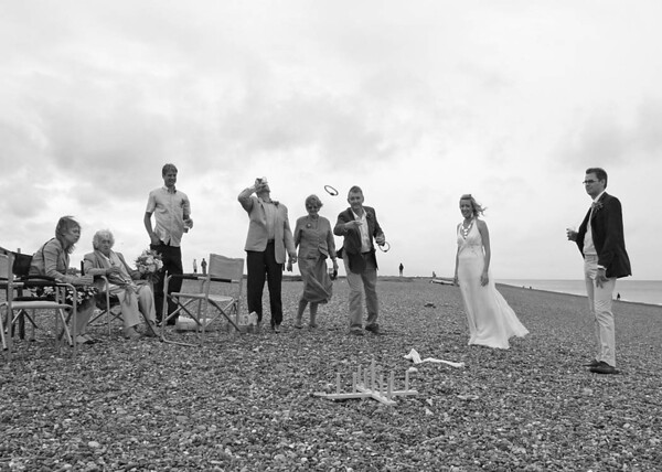Games on Cley Beach before heading back to Cley Windmill for the wedding breakfast