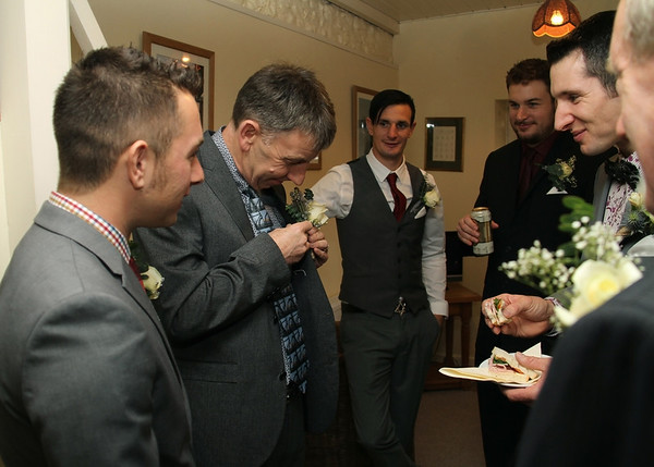 A groom getting ready for his winter wedding at Cley Windmill
