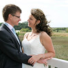 Cley Windmill balcony on their wedding day overlooking the reed beds