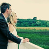How romantic - a bride and groom looking out over the reed beds on their wedding day at Cley Windmill