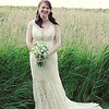 A bride near the reed beds at Cley Windmill looking stunning in her vintage dress