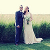 On their wedding day at Cley Windmill in front of the reed beds