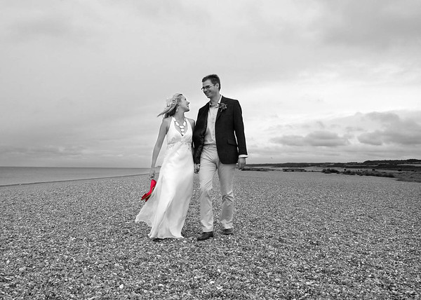 A bride and groom on Cley Beach following on from their wedding ceremony at Cley Windmill