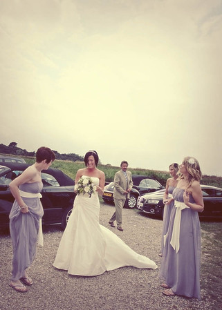 A bride arriving for her wedding at Cley Windmill