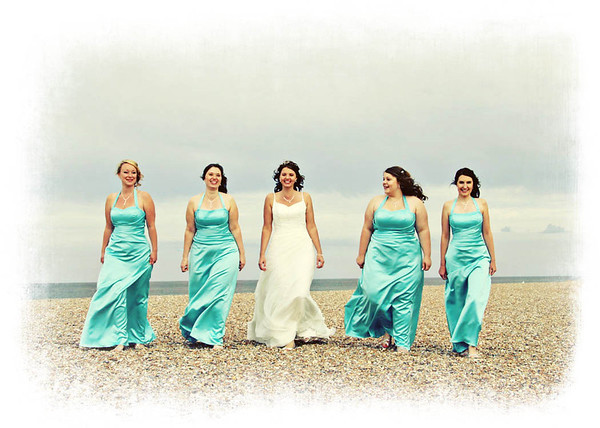 A formal shot of the bride and bridesmaids at Cley Beach before going back to Cley Windmill for their wedding breakfast