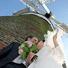 A beautiful bride and groom on a sunny day at Cley Windmill