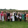 A large formal group shot taken at a wedding at Cley Windmill