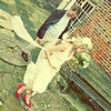 A gorgeous couple and some funky pink bridal shoes at a wedding at Cley Windmill