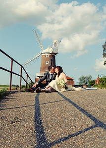 A bride on groom on their summer wedding day at Cley Windmill