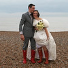 A bride and groom on Cley Beach as part of their winter wedding before returning for their wedding breakfast at Cley Windmill
