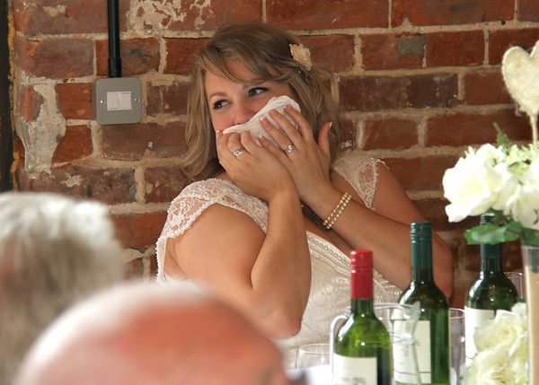 A blushing bride at Dairy Barns during the speeches