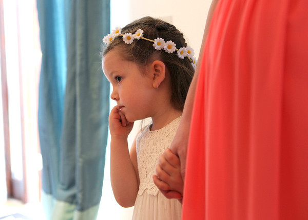 A shy, pretty little flowergirl at Dairy barns