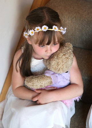 A cuddle with a teddy is all you need when being a flowergirl
