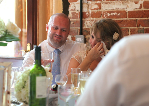 A little tear shed by a bride on her wedding day during the father of the bride speech at Dairy Barns