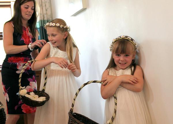 Flowergirls getting ready for a wedding at Dairy Barns