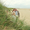A bride and groom down on Sea Palling beach before going back to Dairy Barns for their wedding reception
